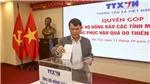 Thông tấn xã Việt Nam quyên góp ủng hộ đồng bào miền Trung bị thiên tai, bão lũ
