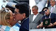 Maradona trao bạn gái nụ hôn kiểu Pháp trên khán đài ngày Argentina bị loại