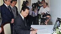 Thủ tướng Nguyễn Tấn Dũng ký sổ tang nguyên Thủ tướng Singapore Lý Quang Diệu