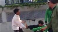 Hà Nội: Tranh giành khách, tài xế Grab Bike cầm gạch ném tài xế xe ôm