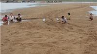 Dạy con nghịch cát