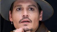 Không phải Brad Pitt, David Beckham mà Johnny Depp là người nhiều phụ nữ muốn hôn nhất dịp Giáng sinh?