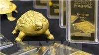 Giá vàng thế giới rơi xuống mức thấp nhất trong một tuần