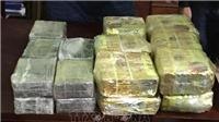 Hai án tử hình, bốn án tù chung thân cho 'đại gia đình' mua bán 80 bánh heroine