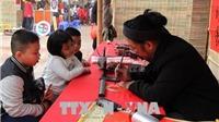 Hơn trăm nghìn người 'xin chữ'đầu năm tại Văn MiếuQuốc Tử Giám