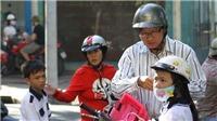 Tháng 9/2019, tập trung xử lý hành vi chở trẻ em đi xe máy không đội mũ bảo hiểm
