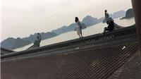 Cặp đôi trèo lên mái chùa chụp ảnh bị dân mạng 'ném đá'