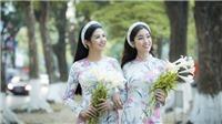 Ngọc Hân - Mỹ Linh 'đọ sắc' trong áo dài họa tiết hoa loa kèn