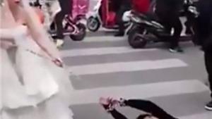 VIDEO: Cô dâu xích tay, lôi xềnh xệch chú rể tới đám cưới