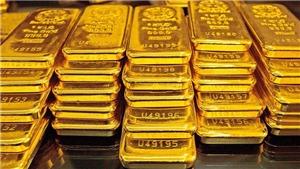 Giá vàng thế giới giảm xuống mức thấp của hai tuần trong phiên 21/4