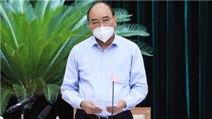 Chủ tịch nước Nguyễn Xuân Phúc: Giãn cách phải gắn chặt với việc chăm lo đời sống cho người dân
