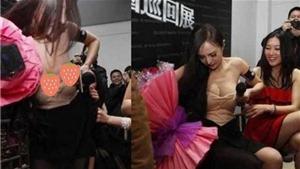 Dương Mịch thể hiện bản lĩnh ngôi sao khi bị fan kéo tụt váy trước công chúng