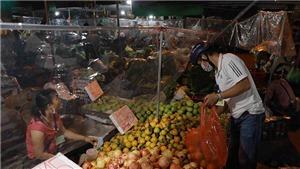 Chùm ảnh: Đêm ở chợ đầu mối Hà Nội mở lại mùa Covid