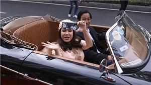 Danh hài Việt Hương lộng lẫy đi xe mui trần cổ điển dự sự kiện